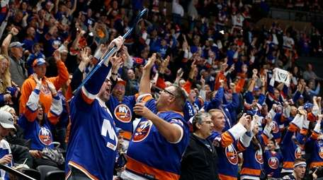 Islanders fans celebrates a goal in the third