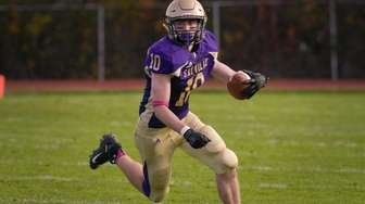Nathan Casaburi of Sayville catches the pass for