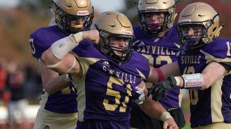Max llewellyn of Sayville celebrates his sack during