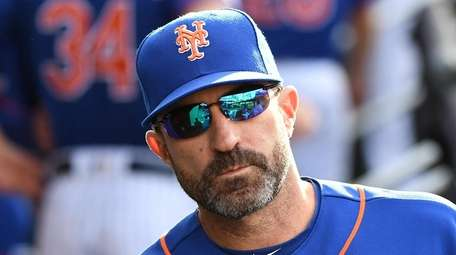 Mets manager Mickey Callaway looks on from the