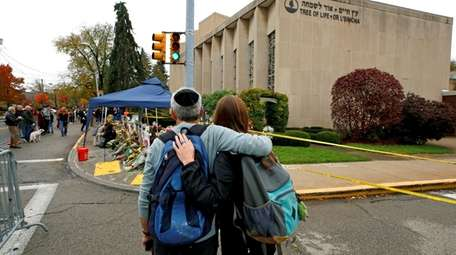 People pay their respects Thursday, Nov. 1, 2018,