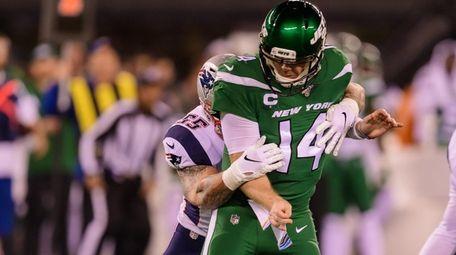 Jets quarterback Sam Darnold loses a fumble during