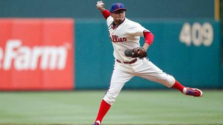 Freddy Galvis fields the ball in the sixth