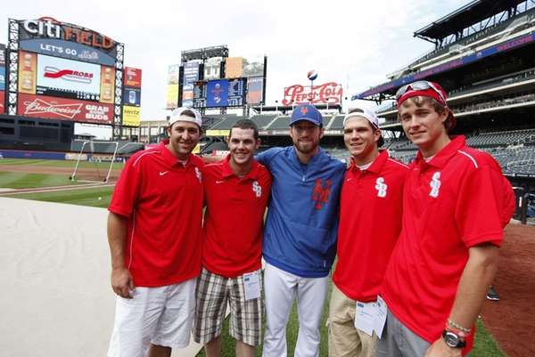 New York Mets' Ike Davis, center, poses with