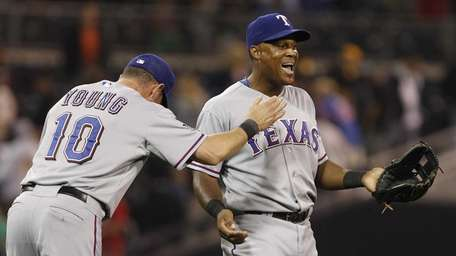 Texas Rangers' Adrian Beltre, right, and Michael Young