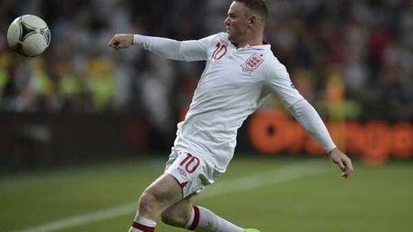 English forward Wayne Rooney (FILIPPO MONTEFORTE/AFP/Getty Images))