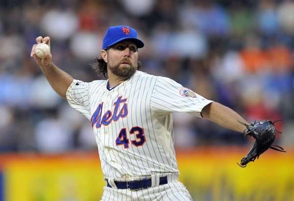 Mets' starter R.A. Dickey pitches against the Baltimore