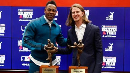 Milwaukee Brewers Josh Hader, right, and New York