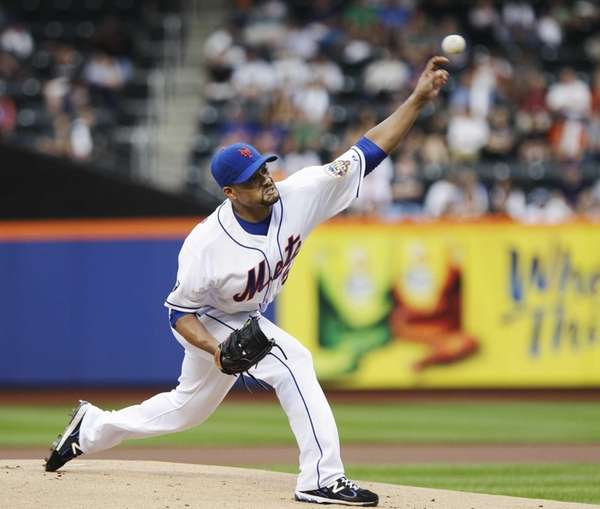 New York Mets' Johan Santana delivers a pitch