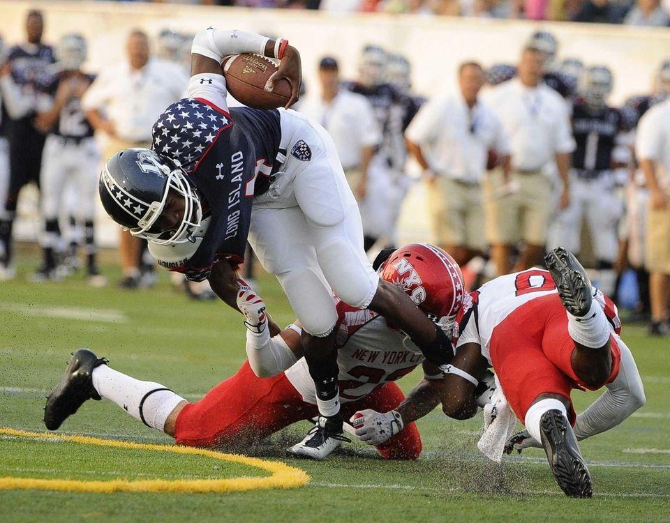 Long Island quarterback Isaiah Barnes gains nine yards