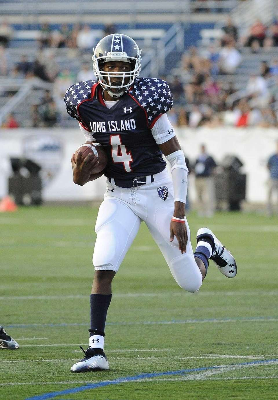 Long Island quarterback Isaiah Barnes drives the ball
