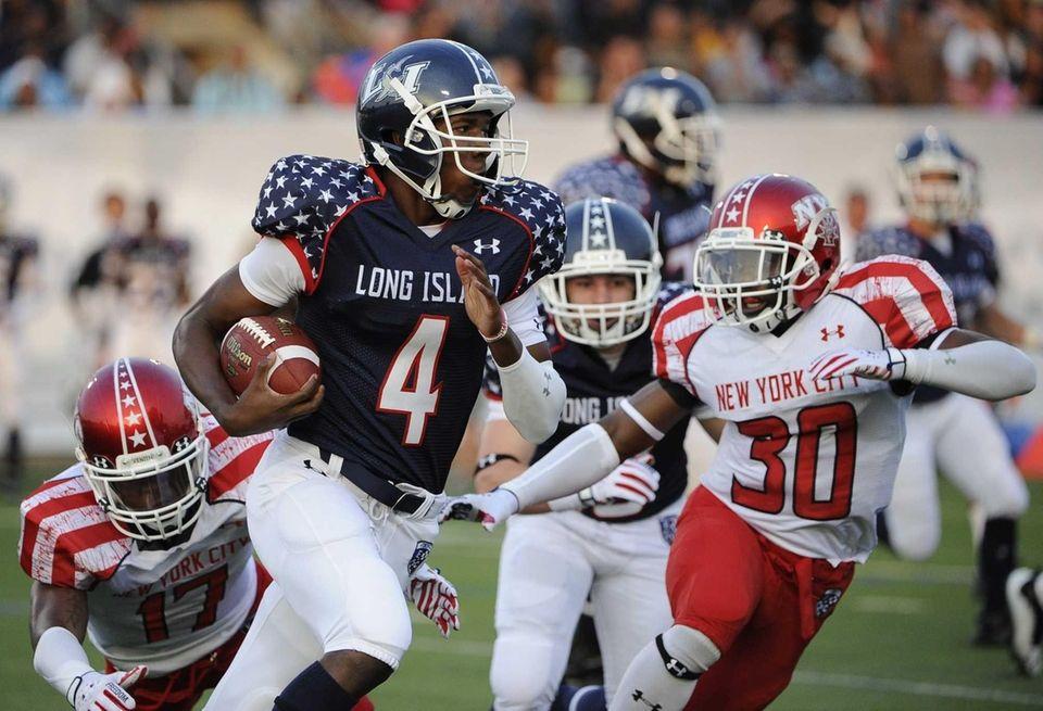 Long Island quarterback Isaiah Barnes drives the ball