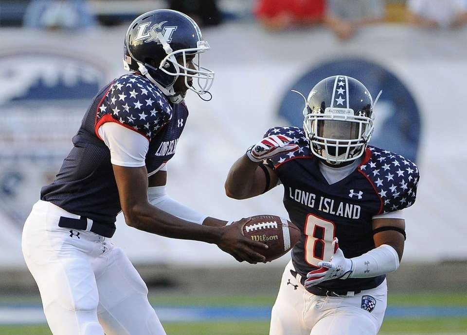 Long Island quarterback Isaiah Barnes hands the ball