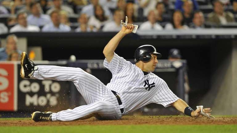 Mark Teixeira looks back to see home plate