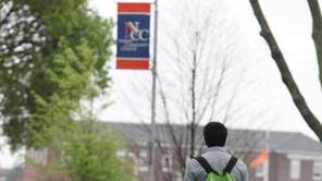 A student walks through the campus of Nassau
