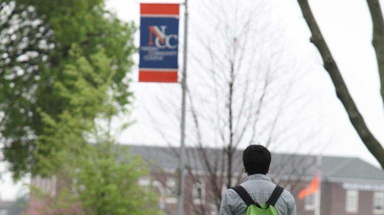 A student walks through the campus of Nassau