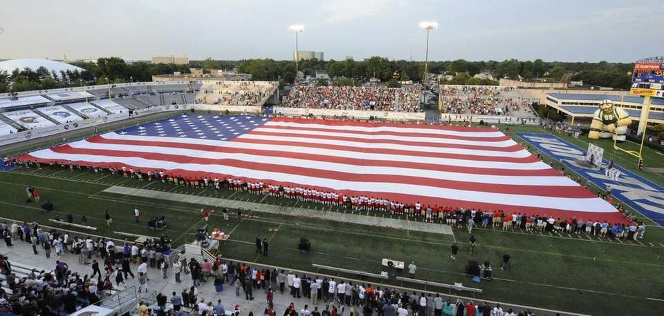A flag is stretched across the field at