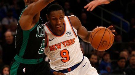 RJ Barrett of the Knicks drives against Kemba