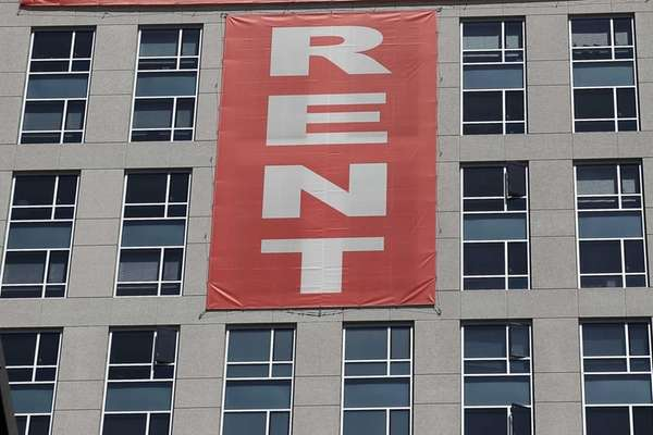 A large rent banner is posted on the