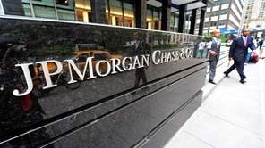 Men walk out of JP Morgan Chase &