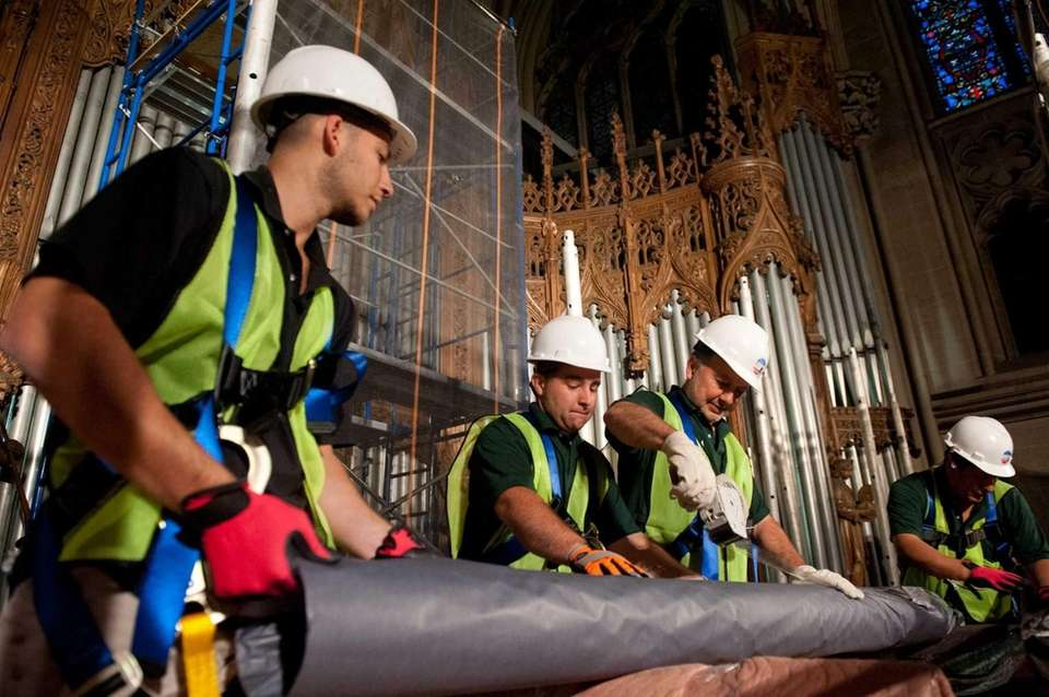 Members of the Peragallo Pipe Organ Company wrap