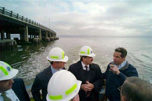 Then Gov.-elect Andrew Cuomo, right, conducts an inspection