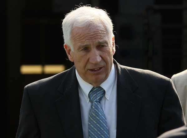 Jerry Sandusky leaving the Centre County Courthouse, on