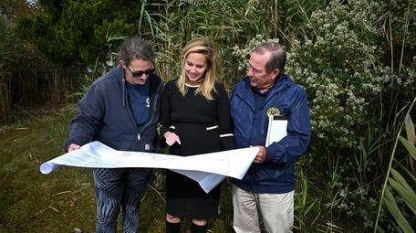 Hempstead Conservation and Waterways employee Kim Lamonica, left,