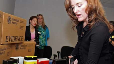 Nassau County District Attorney Kathleen Rice looks over
