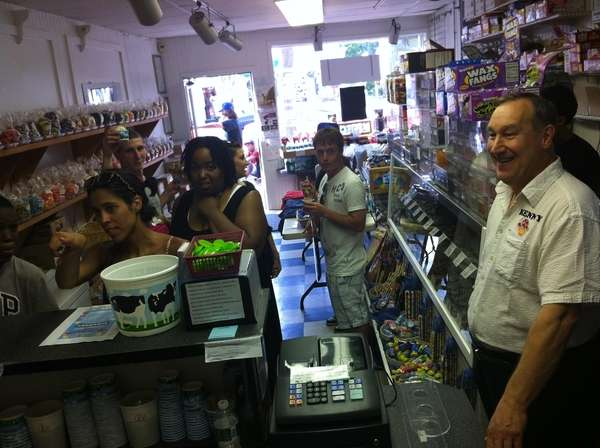 Kenny Schnabel, owner of Main Street Sweets, greets