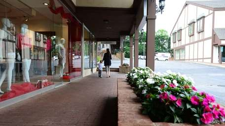 Shoppers at the Woodbury Common shopping center on