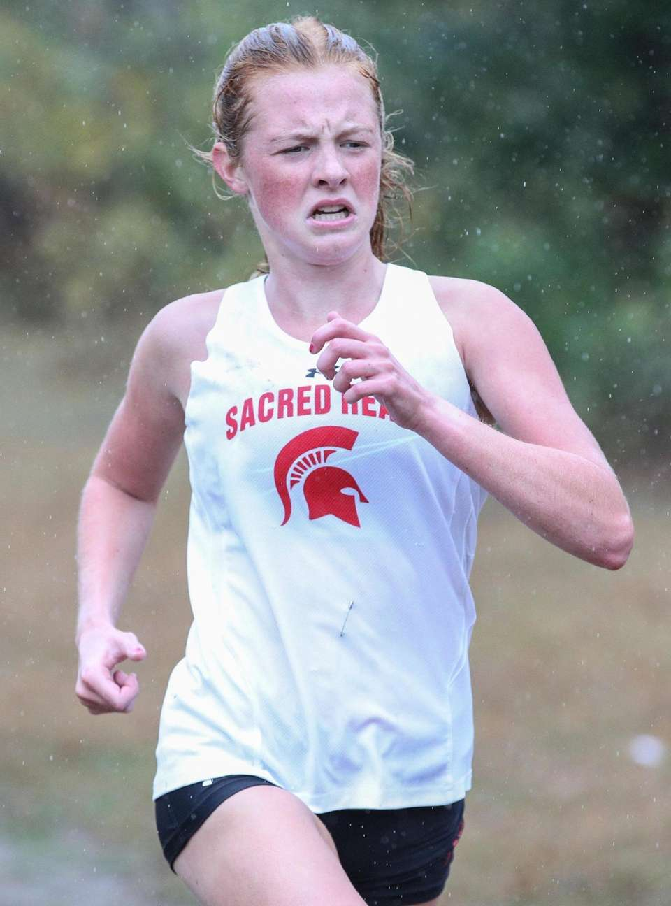 Shannon Thieke of Sacred Heart crosses the finish