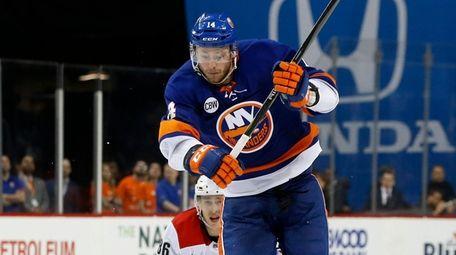 Tom Kuhnhackl of the Islanders skates against Teuvo