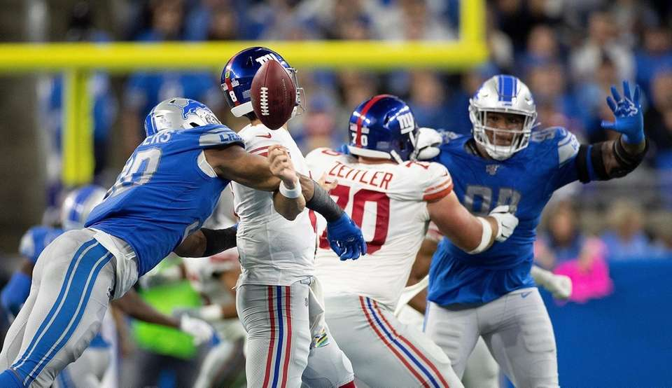 Trey Flowers of the Detroit Lions sacks Daniel