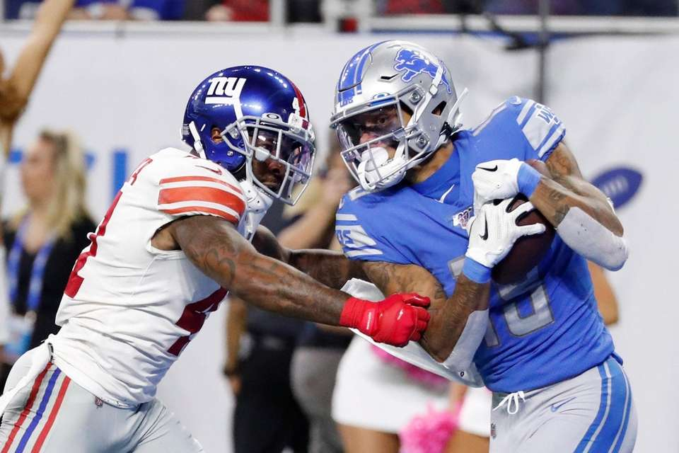 Detroit Lions wide receiver Kenny Golladay, defended by
