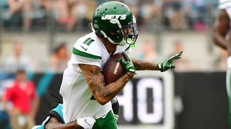 Robby Anderson of the Jets gets tackled by