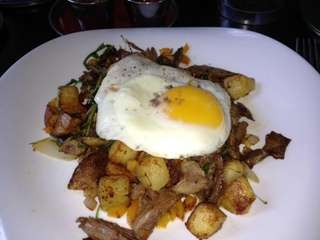 Duck confit hash with potatoes and fried egg