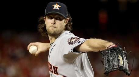 Gerrit Cole of the Astros delivers the pitch