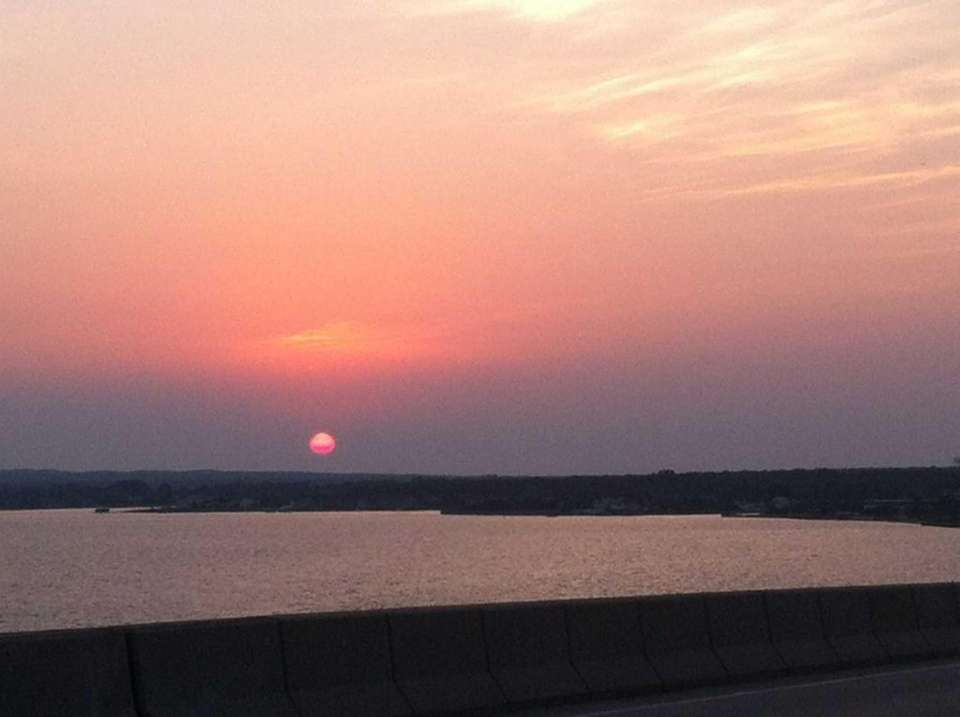 A view of the sunset from Ponquogue Bridge