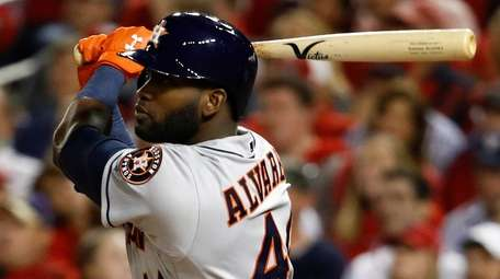 Houston Astros' Yordan Alvarez watches his two-run home