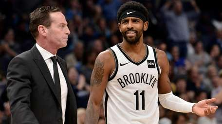 Nets guard Kyrie Irving and head coach Kenny