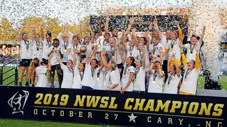 The North Carolina Courage celebrate with the championship