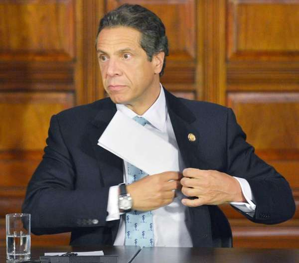 Gov. Andrew Cuomo pockets his notes as he