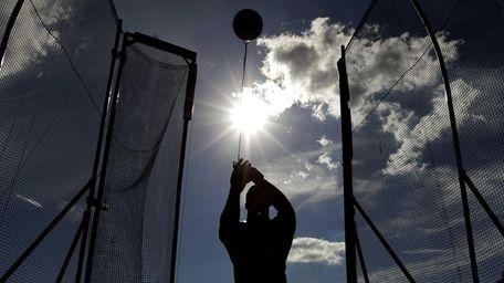 Kibwe Johnson competes at the men's hammer throw