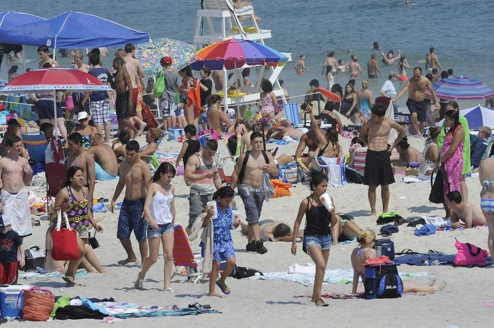 Crowds cool off at Smith Point Park. (June