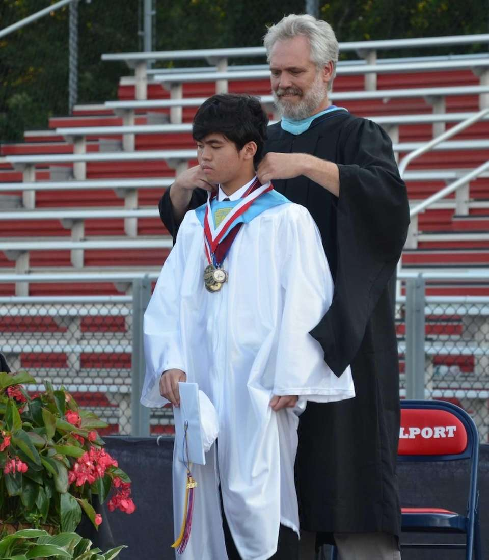 Valedictorian Mark Maranan, received a medal from Bellport