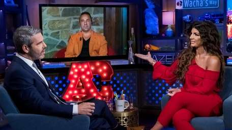 Andy Cohen (left) interviews  Joe Giudice and
