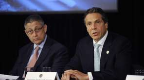 Gov. Andrew Cuomo, right, speaks at a news