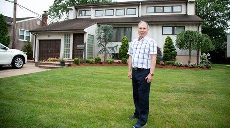 Steve Epstein outside his Valley Stream home.