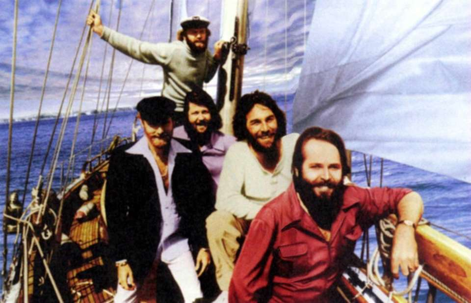 Members of The Beach Boys pose in this